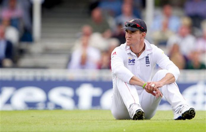 England's Kevin Pietersen sits on the pitch during the third day of the first cricket test match against South Africa at the Oval cricket ground