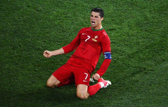 Cristiano Ronaldo of Portugal celebrates scoring his team's second goal during the Uefa Euro 2012.