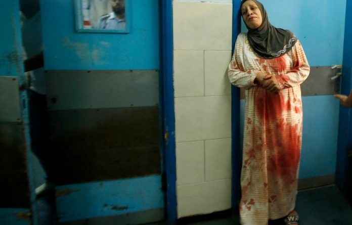 Collateral bloodshed: Palestinian civilians are being caught in the crossfire of a war that is seemingly supported by the majority of Jewish Israelis.