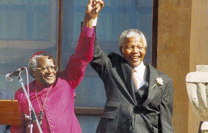 Archbishop Emeritus Desmond Tutu and former president Nelson Mandela.