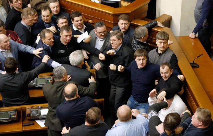 Ukrainian lawmakers clash during a Parliament session in Kiev.