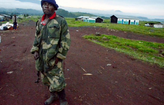 A Congolese army soldier outside the deserted town of Kibumba after residents fled fighting between Congolese army deserters led by Bosco Ntaganda and the regular army.