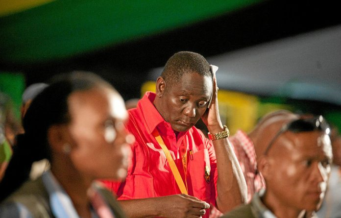 Unions affiliated to Cosatu meet to decide on the fate of general secretary Zwelinzima Vavi following allegations of sexual misconduct with a junior employee at the Cosatu offices.