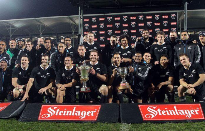The All Blacks celebrate their win.