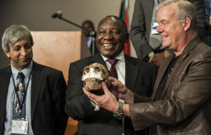 Deputy President Cyril Ramaphosa and Professor Lee Berger hold a replica of the skull of a Homo naledi during the unveiling of the discovery.