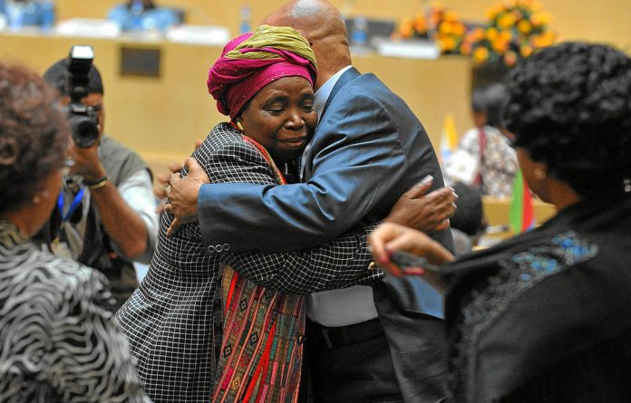 Nkosazana Dlamini-Zuma is congratulated by President Jacob Zuma after being sworn in as head of the African Union Commission.