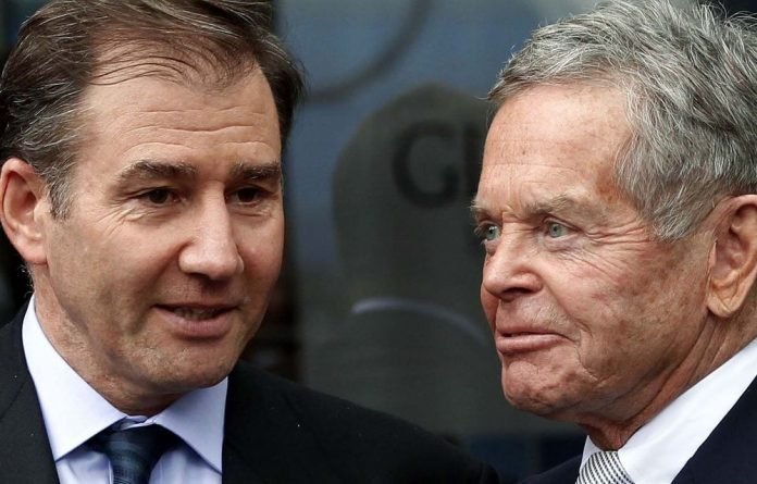 Glencore chief executive Ivan Glasenberg and chair Simon Murray after a company shareholder meeting.