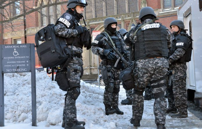 Tactical police assemble outside a building at Harvard University. Four buildings on campus were evacuated after campus police received an unconfirmed report that explosives may have been placed inside.