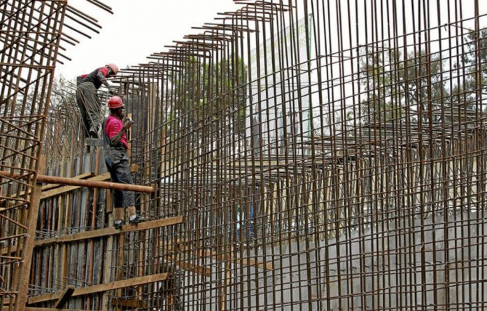 Workers erect a bridge in Nairobi as part of a project that is funded by the governments of Kenya and China and the African Development Bank.