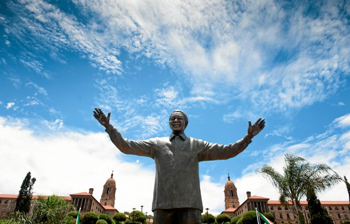 A 9m statue of Nelson Mandela outside the Union Buildings. Dali Tambo's company won the tender to erect this huge statue for an equally huge price tag of R8-million.