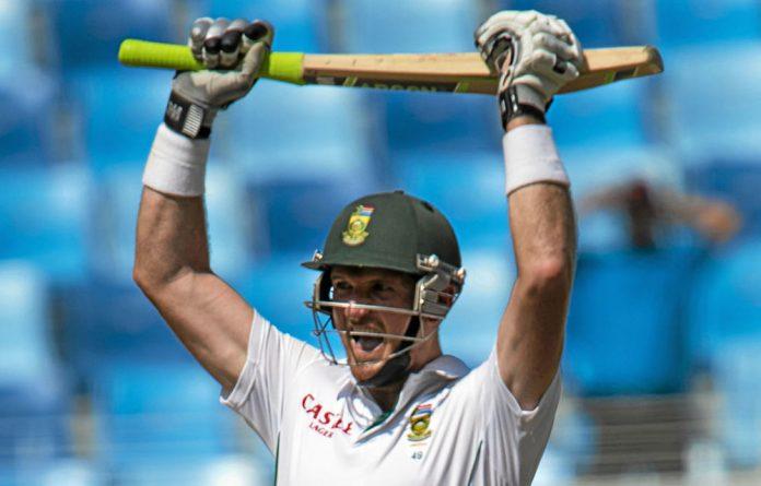 Graham Smith celebrates reaching 100 against Pakistan.