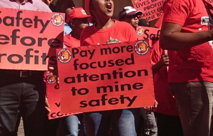 Cosatu and the Num picketed against flouted health and safety rules