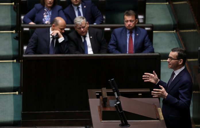 Poland's Prime Minister Mateusz Morawiecki speaks during a debate about the Holocaust Bill at the lower house of Parliament.