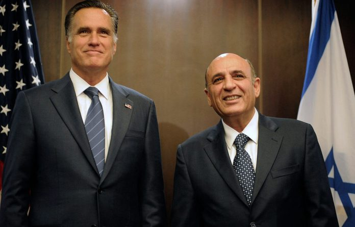 US Republican presidential hopeful Mitt Romney and Israel's Kadima party leader Shaul Mofaz pose for photographers during a meeting in Jerusalem.