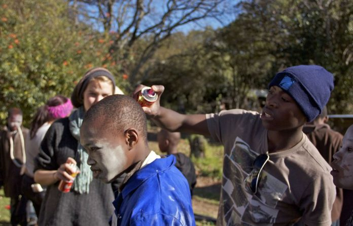 Kwanele September helps another Art Factory participant get into character.