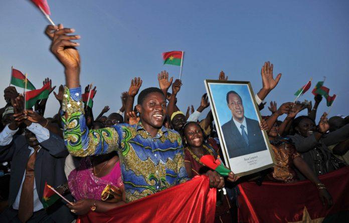 Still popular: Burkina Faso nationals cheer for their president