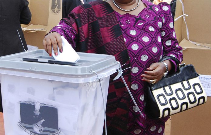 Incumbent Malawian President Joyce Banda votes in her home district of Malemia during May 20 elections.