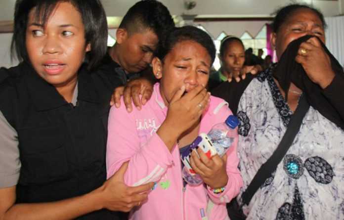 Families of the victims from an Indonesia plane crash grieve the loss of their loved ones.