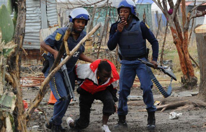 Police arrest a miner in Marikana