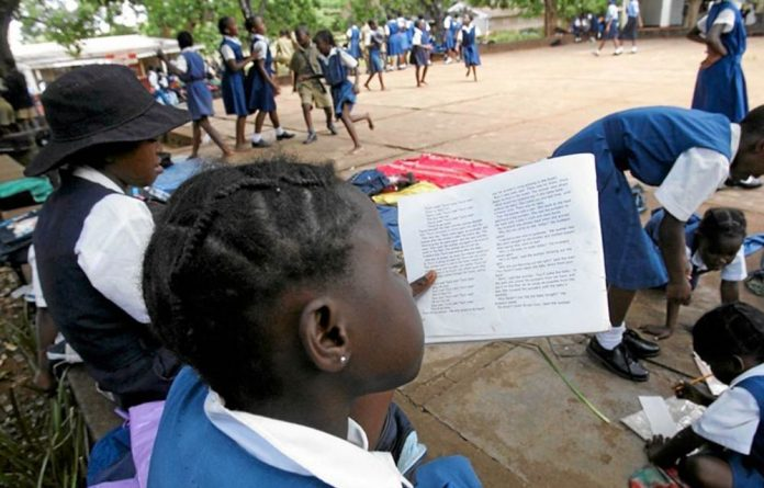 Pupils study outside their classrooms at Courtney Selous Primary School