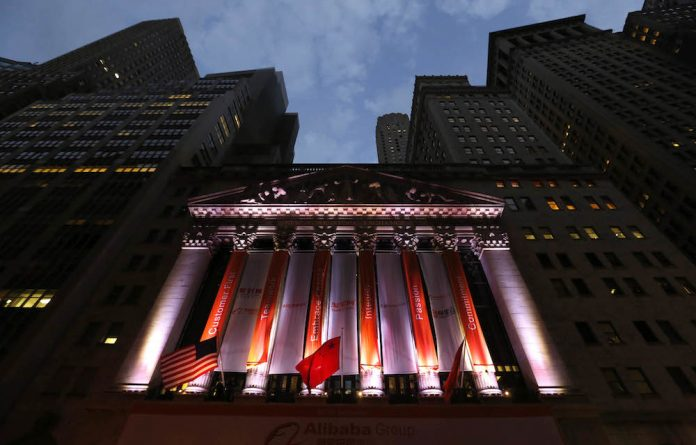 Standard procedure: China's flag flies in front of the New York Stock Exchange before Alibaba's initial public offering.