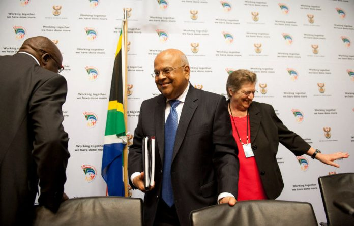 Two people who face serious claims of misconduct now work under minister Pravin Gordhan.