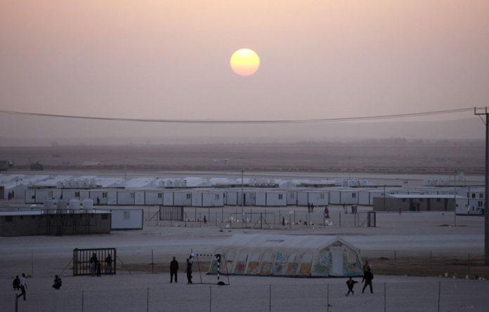 Syrian refugees play soccer at the Zaatari camp