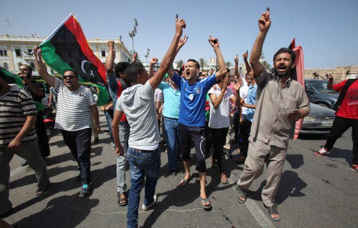 Libyans celebrate in Martyrs' Square in Tripoli on July 7 2012.