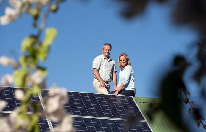 Seeing the light: Mark Bleloch and Leigh de Decker expect their solar investment to be paid off in less than five years.