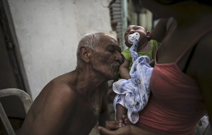 Lifeline: A man kisses his two-month-old great-grandson