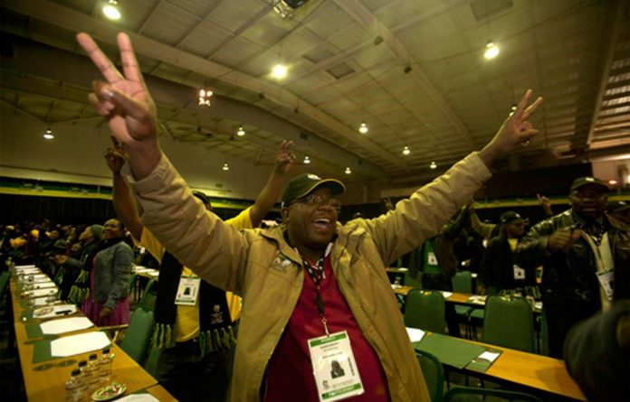 Delegates celebrate at the ANC national policy conference in Midrand
