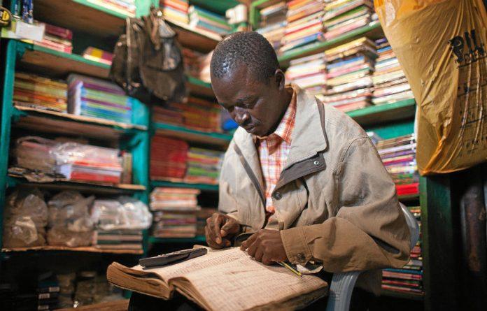 On track:Despite losing everything in his bookshop in Kibera