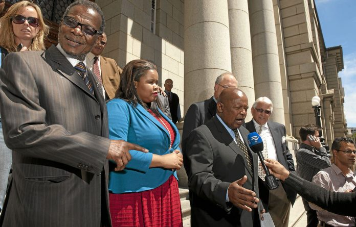 Congress of the People leader Mosiuoa Lekota talks to the media after the application was dismissed.