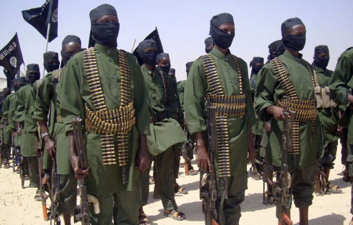 A file photograph from February 17 2011 shows al-Shabaab fighters on the outskirts of Mogadishu