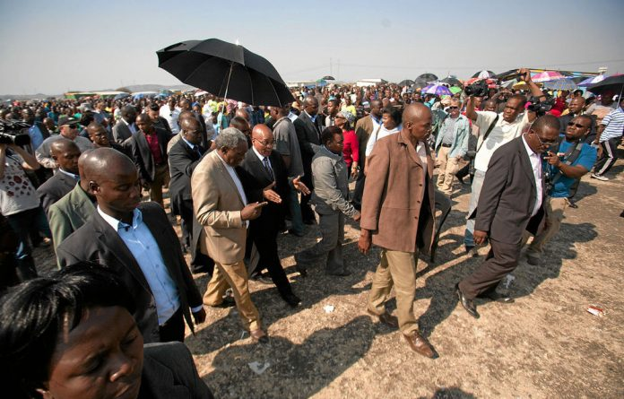 President Jacob Zuma and Intelligence Minister Siyabonga Cwele visit Marikana.