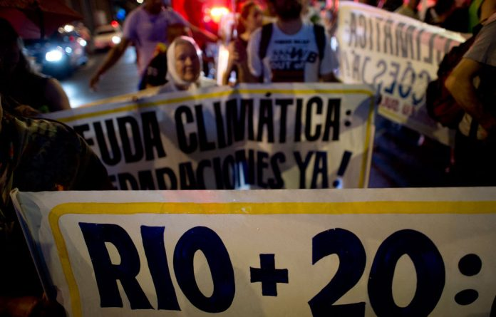 Activists demonstrate against VALE mining company at the business centre in Rio de Janeiro