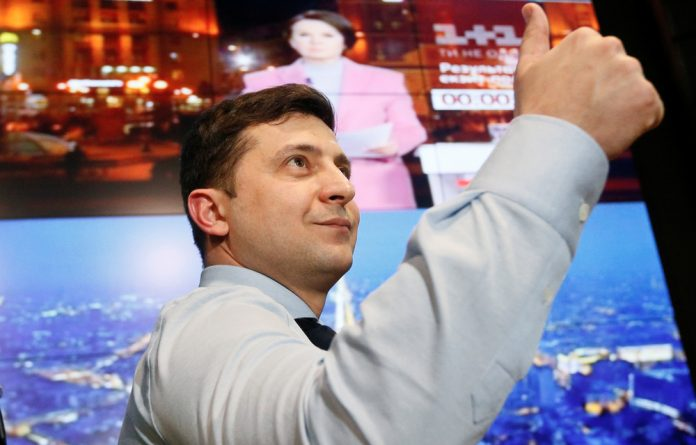 Ukrainian comic and presidential candidate Volodymyr Zelenskiy gives a thumbs up as he visits his campaign headquarters following a presidential election in Kiev