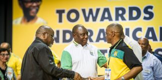 ANC chair Gwede Mantashe oversees a handshake between President Cyril Ramaphosa and secretary general Ace Magashule at the party's national executive committee meeting.