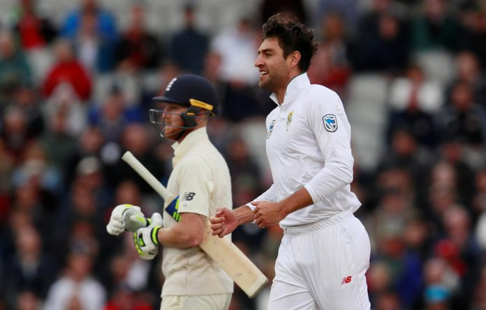 Duanne Olivier celebrates taking the wicket of England's Ben Stokes.