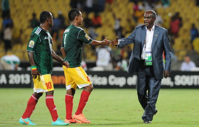 Ethiopia coach Sewnet Bishaw congratulates Abebaw Butako and Berhanu Bogale after an African Cup of Nations match