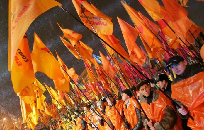 Ukrainians mark the first anniversary of the Orange Revolution in 2005.