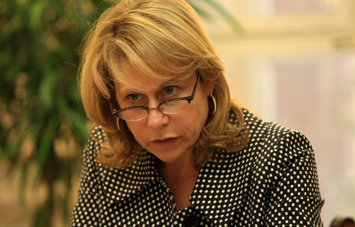 Anglo American's CEO Cynthia Carroll blames apartheid legacy for turmoil at South African mines.