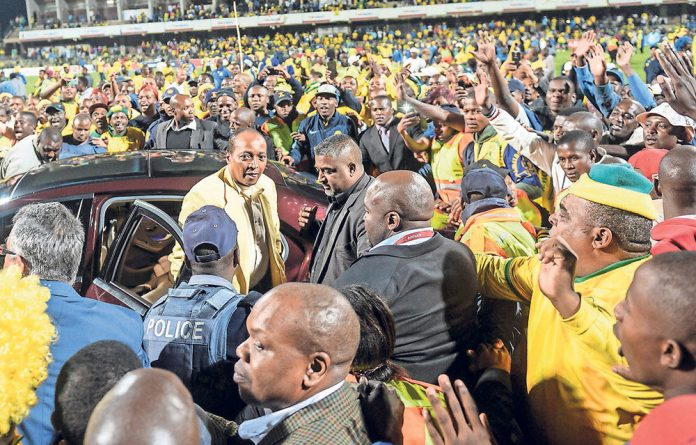 Crowdpleaser: Sundowns owner Patrice Motsepe celebrates with fans on Wednesday night.
