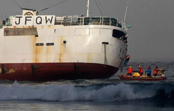A 50m Japanese fishing trawler runs aground at First Beach in Clifton