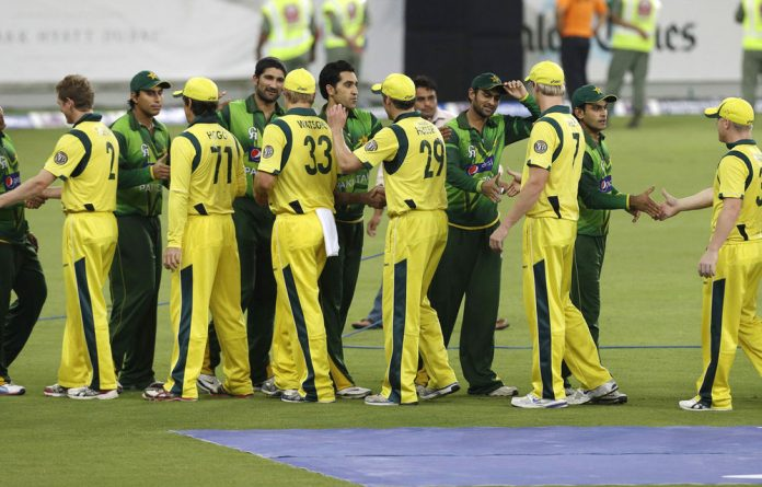 Australia's cricket players shake hands with Pakistan players and coaching staff at the end of the second cricket T20 cricket match.