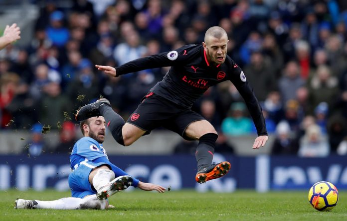 Jack Wilshere in action with Brighton's Glenn Murray.