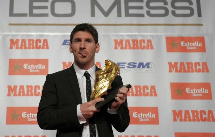 Barcelona's Lionel Messi has been presented with his second Golden Boot award in recognition for scoring the most goals in Europe's domestic leagues.