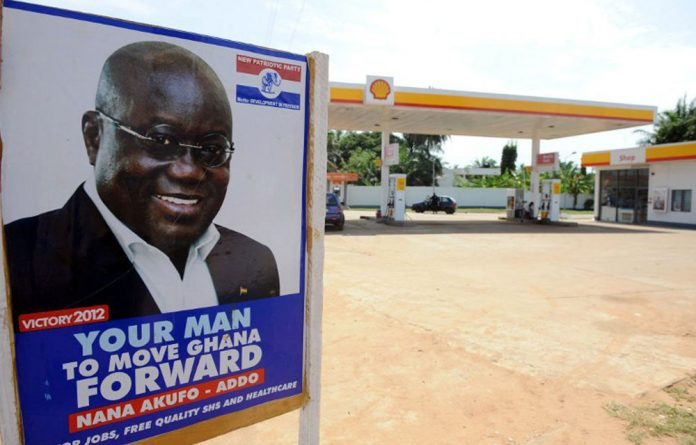 A poster of the presidential candidate of the opposition New Patriotic Party Nana Akufo-Addo is seen at the entrance of a petrol station on October 23 2012 in Accra.