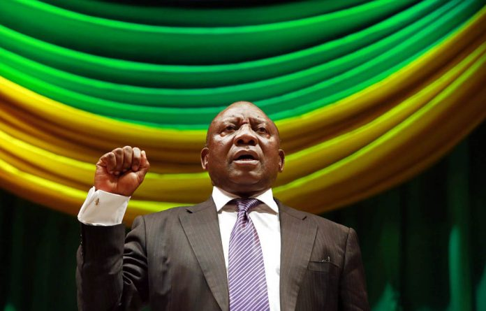 """Deputy president Cyril Ramaphosa's testimony at the Farlam Commission was interrupted by a group of people chanting """"blood on his hands""""."""