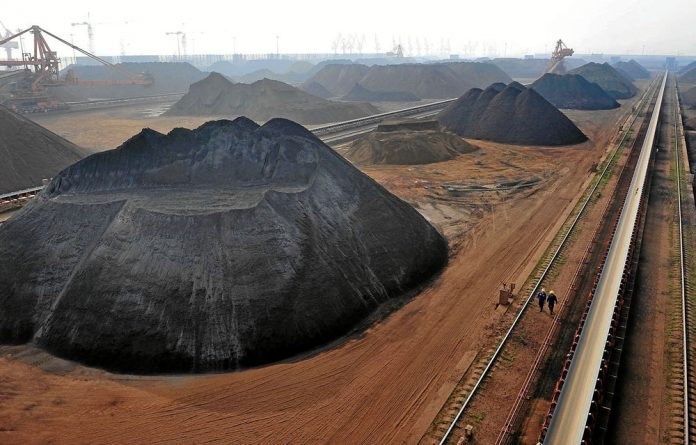 Iron ore storage at Yingkou Port. China mainly imports raw materials from Africa.